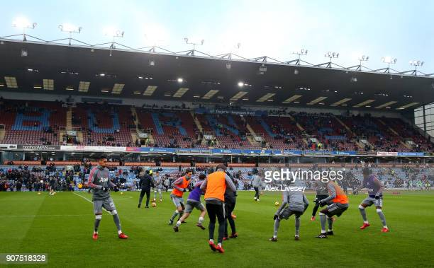The Manchester United team warm up prior to the Premier League match between Burnley and Manchester United at Turf Moor on January 20 2018 in Burnley...