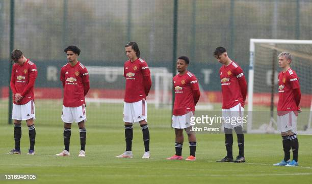 The Manchester United U18s team take part in a minute's silence for Alan McLoughlin ahead of the U18 Premier League match between Manchester United...