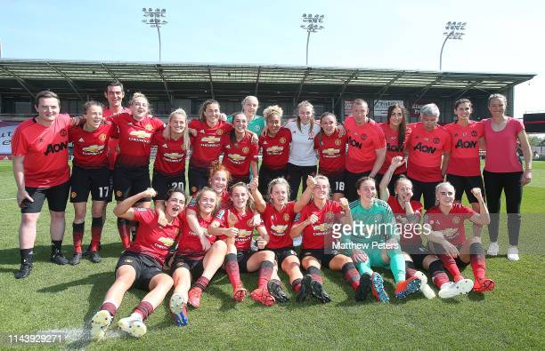 The Manchester United Women squad celebrate winning the League after the WSL match between Manchester United Women and Crystal Palace Women at Leigh...