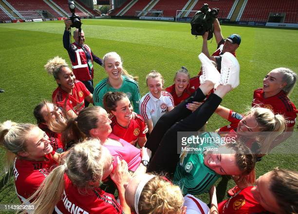 The Manchester United Women squad celebrate winning the League with Manager Casey Stoney after the WSL match between Manchester United Women and...