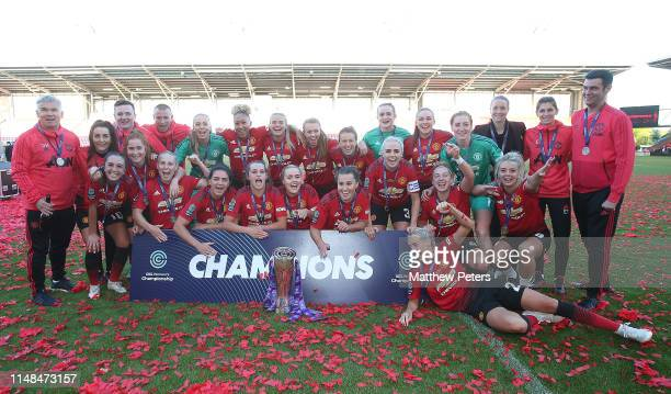 The Manchester United Women squad celebrate with the FA Women's Championship trophy after the WSL match between Manchester United Women and Lewes...