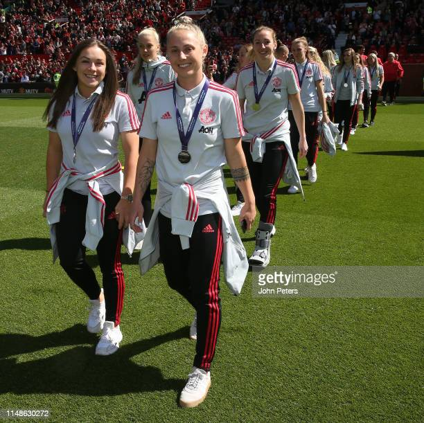 The Manchester United Women squad parade the FA Womens Championship trophy ahead of the Premier League match between Manchester United and Cardiff...