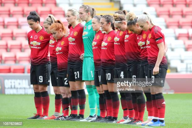 The Manchester United Women take part in a minute's silence ahead of the WSL match between Manchester United Women and Tottenham Hotsput Ladies at...