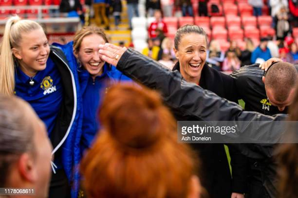 The Manchester United Women team celebrate after the Barclays FA Women's Super League match between Manchester United and Liverpool at Leigh Sports...