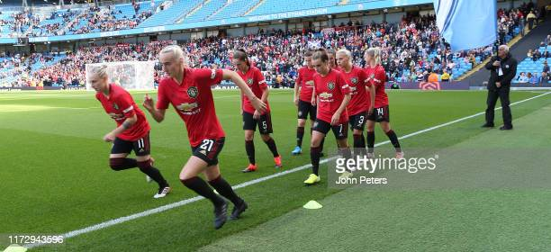 The Manchester United Women team warm up ahead of the Barclays FA Women's Super League match between Manchester City and Manchester United at Etihad...