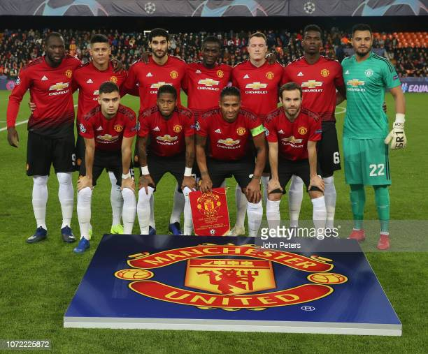 The Manchster United team lines up ahead of the UEFA Champions League Group H match between Valencia and Manchester United at Estadio Mestalla on...