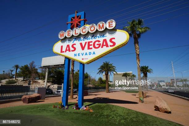 The Mandalay Bay Resort and Casino sits behind the Welcome to Las Vegas sign on the south end of the Las Vegas Strip on October 3 after a mass...