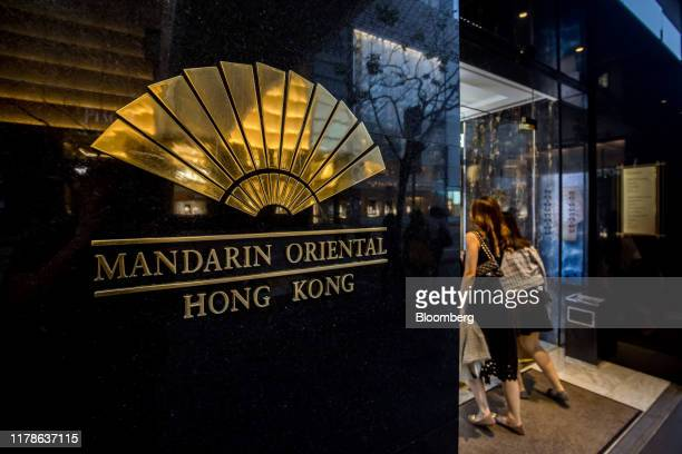 The Mandarin Oriental Hotel Group logo is displayed outside the company's Hong Kong hotel in the Central district of Hong Kong, China, on Sunday,...