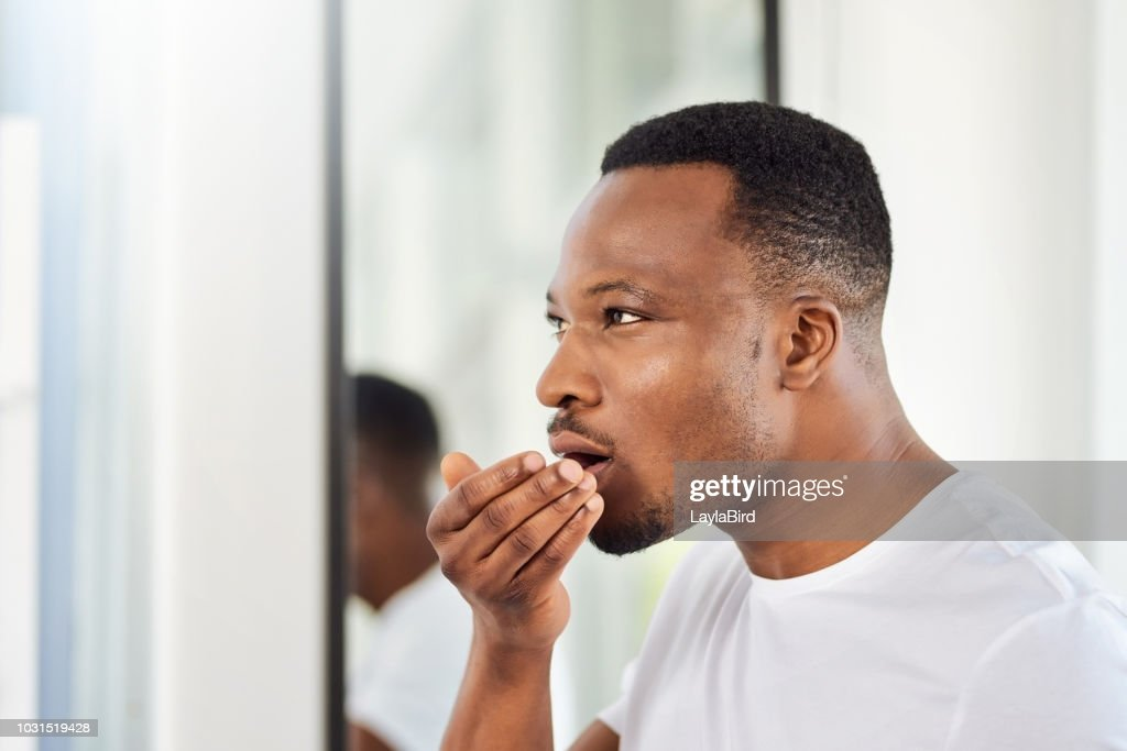 The mandatory morning breath check : Stock Photo
