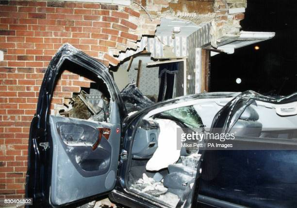 The mangled remains of a stolen car that crashed through a wall of a house destroying the staircase of a pensioner's home trapping him on the first...