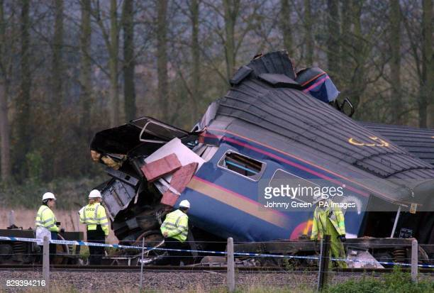 The mangled wreckage of one of the carriages of the train, which hit a saloon car on a remote level crossing near Ufton Nervet in Berkshire. Six...