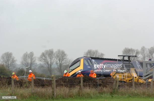 The mangled wreckage of the train which derailed on Saturday at Ufton Nervet, Berkshire. Seven people died when a high speed train ploughed into a...