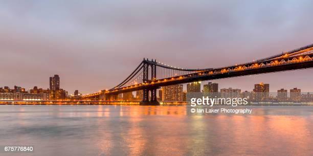 The Manhattan Bridge at dusk , viewed from Brooklyn, New York City, USA.