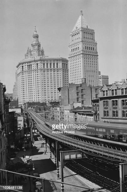 The Manhattan Municipal Building and Thurgood Marshall United States Courthouse, as seen from Chatham Square Station in Manhattan, New York City,...