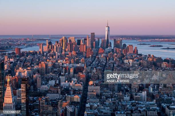 The Manhattan skyline is seen at sunrise from the 86th floor observatory of the Empire State Building on April 3 in New York City. - The Empire State...