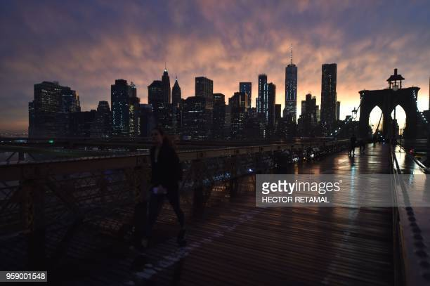 TOPSHOT The Manhattan skyline is seen from the Brooklyn Bridge following a downpour in New York City on May 15 2018