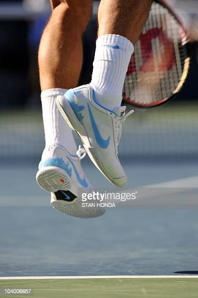 The Manhattan skyline is seen on the shoes of Roger Federer of Switzerland  as he serves 2dc232711