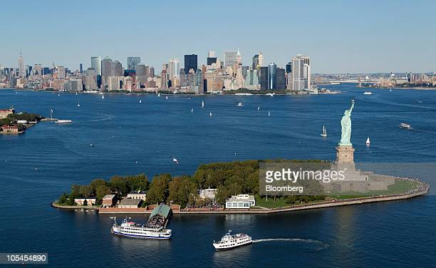 The Manhattan skyline stands beyond the Statue of Liberty in this aerial photograph taken over New York US on Saturday Oct 2 2010 New York City sold...