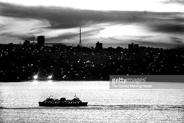 The Manly Ferry courses its way to Circular Quay at dusk on Wednesday 20 June 2001.