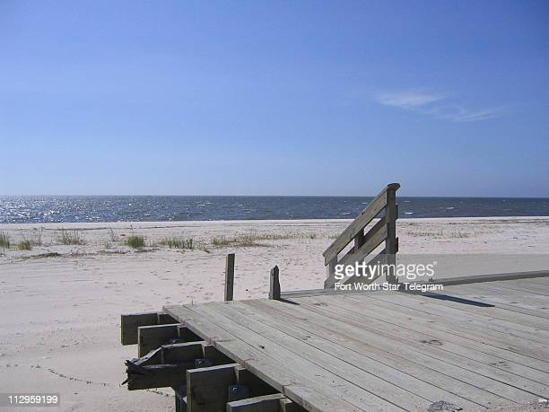 The manmade beach along Highway 90 is cleaned up but not ready for swimmers yet in Biloxi Mississippi