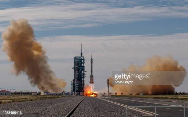 The manned Shenzhou-12 spacecraft from China's Manned Space Agency onboard the Long March-2F rocket launches with three Chinese astronauts onboard at...