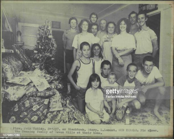 The Manning family of Seven Hills at their homeThe Manning Family Back Ronny 16 Anne 22 Sid 18 David 17 Harry amp Barbara Wayne 20 kneeing Darren...
