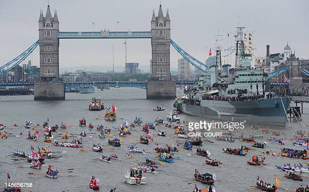 The manpowered section is pictured rowing towards Tower Bridge during the Diamond Jubilee Pageant on the River Thames in London on June 3 2012...