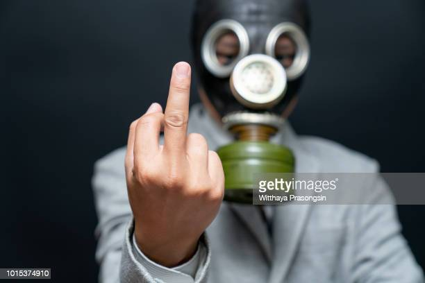 The man's hand shows an indecent gesture fuck you pollution