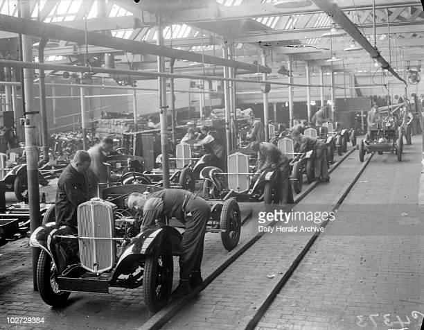 'The Manufacture of Triumph Cars at Triumph Works Coventry' 1933 A photograph of workers at the Triumph Works in Coventry England taken by Leslie...