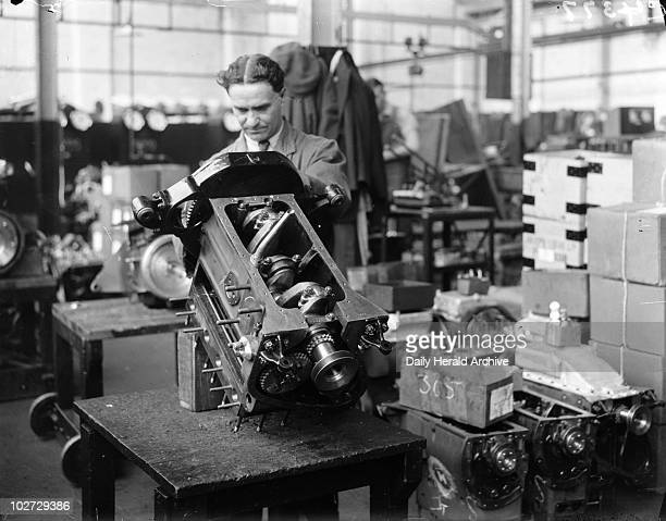 'The Manufacture of Triumph Cars at Triumph Works Coventry' 1933 A photograph of a man working at the Triumph Works in Coventry England taken by...
