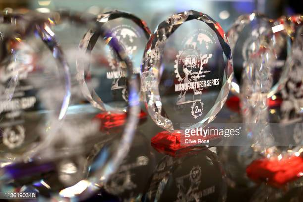 The Manufacturers series trophies are seen ahead of the Manufacturers Cup Final during the Gran Turismo Sport FIA 2019 World Tour event at Pavillon...
