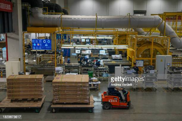 The manufacturing plant of Keeson Technology Corp. Ltd, manufacturer of smart beds, is seen during a state organized media trip to observe the...