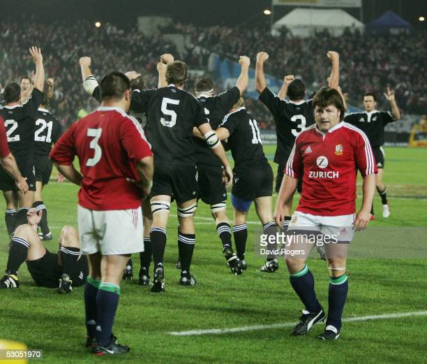The Maori celebrate as Shane Byrne and Julian White look on dejected after the match between the British and Irish Lions and New Zealand Maori at The...