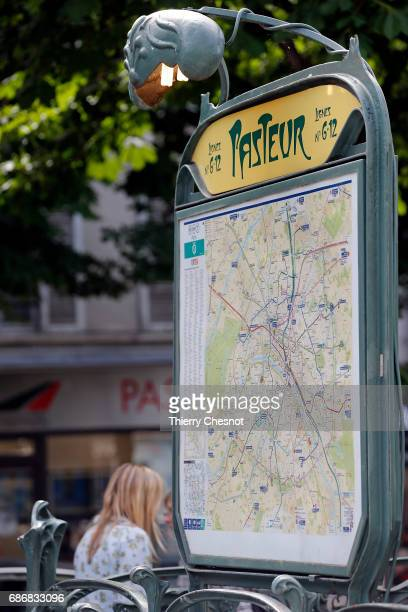 The map of the Paris subway lines is seen at the 'Pasteur' station on May 22 2017 in Paris France The entrance to this subway station was designed by...