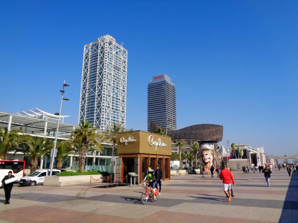 The Mapfre Tower and the Hotel Arts tower with the goldfish sculpture designed by Frank Gehry in the waterfront promenade of Port Olimpic of Barcelona, Catalonia, Spain
