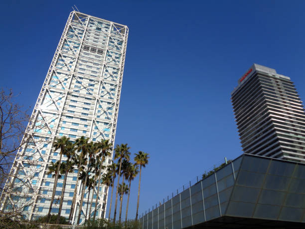 The Mapfre Tower and the Hotel Arts tower with the goldfish sculpture designed by Frank Gehry in the Port Olimpic of Barcelona, Catalonia, Spain