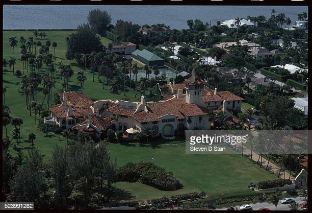 The Mar-a-Lago Estate, owned by Donald Trump, lies at the water's edge in Palm Beach, Florida. The mansion was built by Marjorie Merriweather Post in...