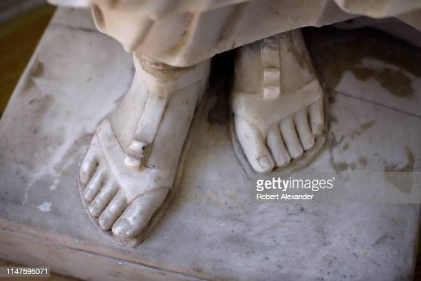 The marble feet of an Italian statue of a woman for sale in an antique shop in Santa Fe, New Mexico.