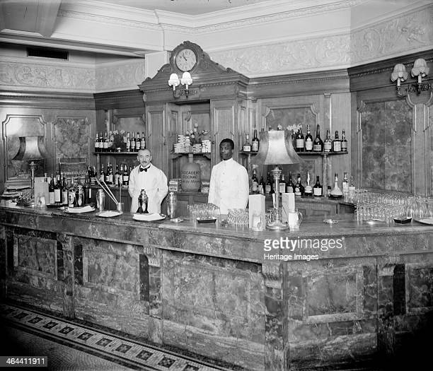 The marble 'Long Bar' in the Trocadero Restaurant c1950 With two bar tenders in white coats standing behind the bar that has been laid out with...