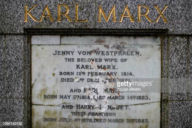 TOPSHOT The marble plaque showing damage from recent vandalism on the front of the tomb of German revolutionary philosopher Karl Marx a Grade Ilisted...