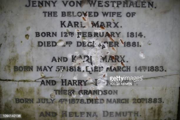 The marble plaque showing damage from recent vandalism on the front of the tomb of German revolutionary philosopher Karl Marx a Grade Ilisted...