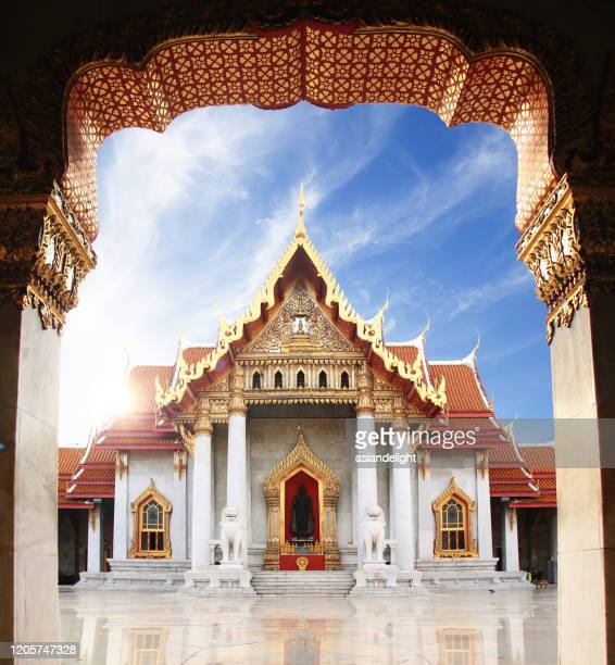 the marble temple or wat benchamabophit dusit wanaram in morning time with sun beam on top of church, famous landmark place for tourist sight seeing in bangkok thailand - bangkok stock pictures, royalty-free photos & images