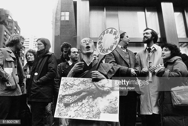 The March and Rally for Peace and Disarmament an antinuclear protest in New York City 12th June 1982 An Asian man holds a photograph of a young...