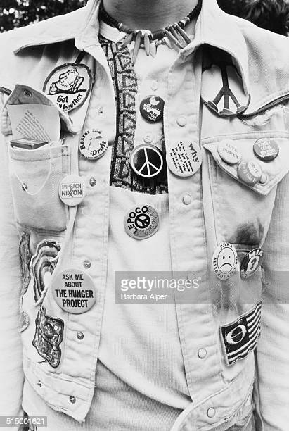 The March and Rally for Peace and Disarmament an antinuclear protest in New York City 12th June 1982 A protestor in Central Park wears several badges...