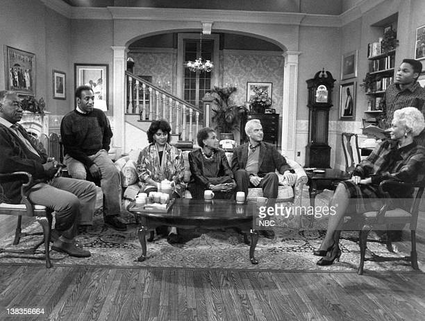 "The March"" Episode 6 -- Air Date -- Pictured: Joe Williams as Al Hanks, Bill Cosby as Dr. Heathcliff 'Cliff' Huxtable, Phylicia Rashad as Clair Hanks..."