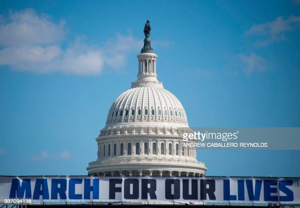 TOPSHOT The March For Our Lives stage sign is seen near the capitol ahead of the antigun rally in Washington DC on March 23 2018