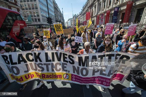 The march proceeds down Piccadilly as over one thousand people protest against proposed new powers for the police on April 17, 2021 in London,...