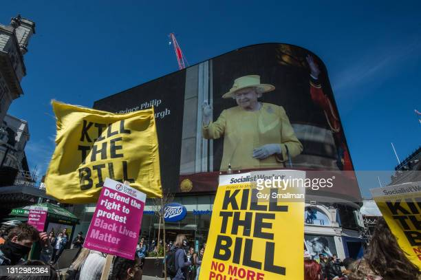 The march proceeds through Piccadilly Circus past a bill board commemorating Prince Philip as over one thousand people protest against proposed new...