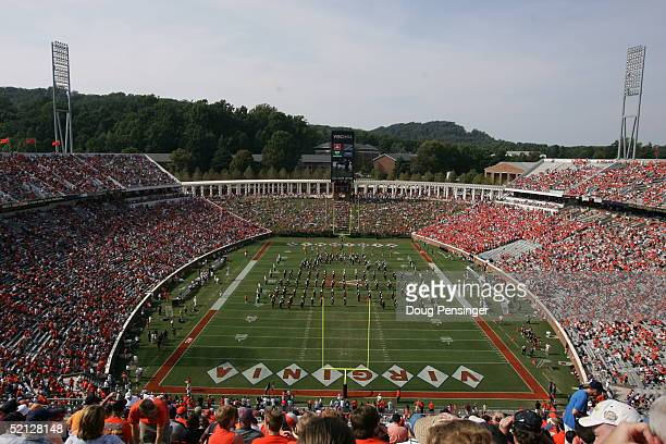 The marching band of the Virginia Cavaliers performs before the team plays against the Syracuse Orangemen at Scott Stadium on September 25, 2004 in...