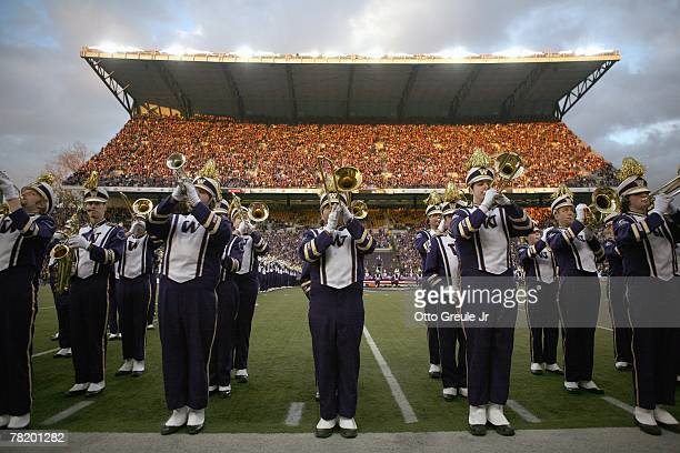 The marching band of the Washington Huskies play on the field during the 100th Apple Cup game against the Washington State Cougars at Husky Stadium...